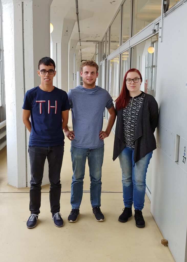 Darius, Jari and Daniëlle posing in the hallway next to the Teqplay Office at the Van Nelle Fabriek in Rotterdam, the Netherlands